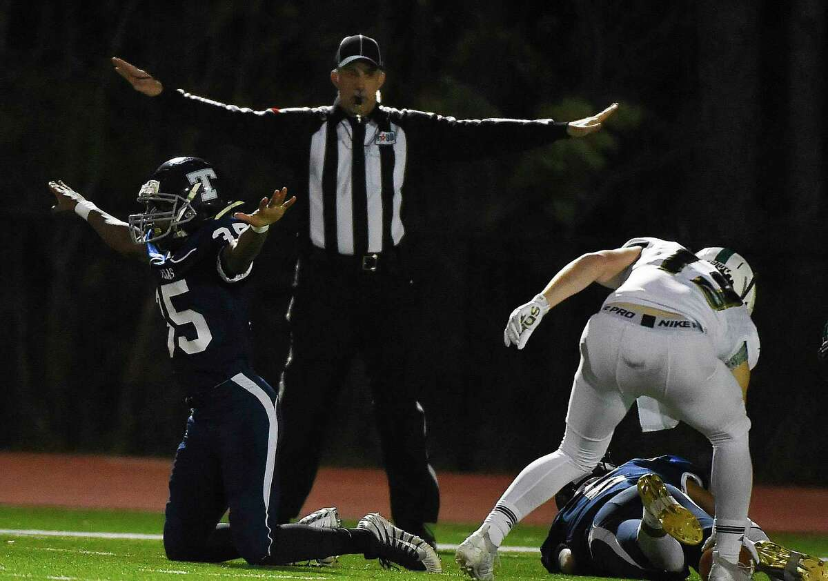 TSD defensive back Broderick Johnson, left, reacts after breaking up a pass intended for TWCA wide receiver Caedmon Parker, right, during the first half of a TAPPS Division III regional high school football playoff game, Friday, Nov. 22, 2019, in The Woodlands.