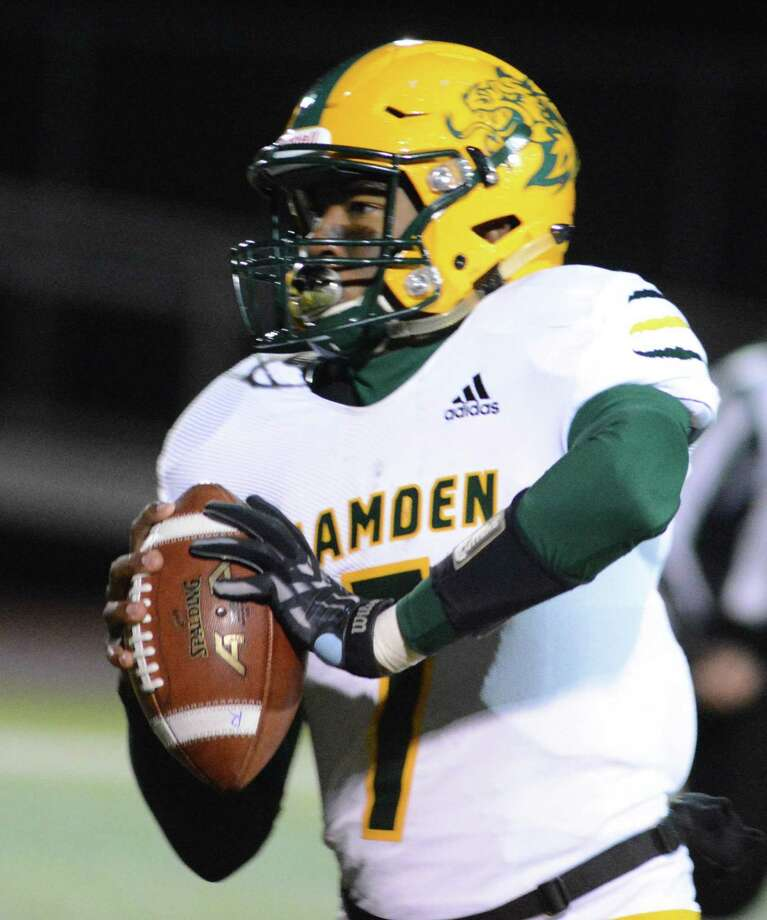 Hamden QB Isaiah Riley passes against Sheehan on Friday. Photo: Dave Phillips / For Hearst Connecticut Media / Stamford Advocate Freelance