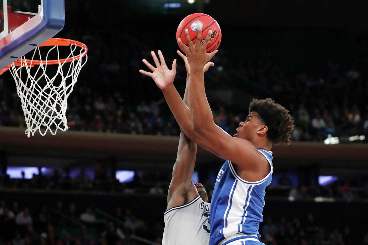 Duke center Vernon Carey Jr. (1) shoots over Georgetown guard James Akinjo (3) during the first half of an NCAA college basketball game in the 2K Empire Classic, Friday, Nov. 22, 2019 in New York. (AP Photo/Kathy Willens)