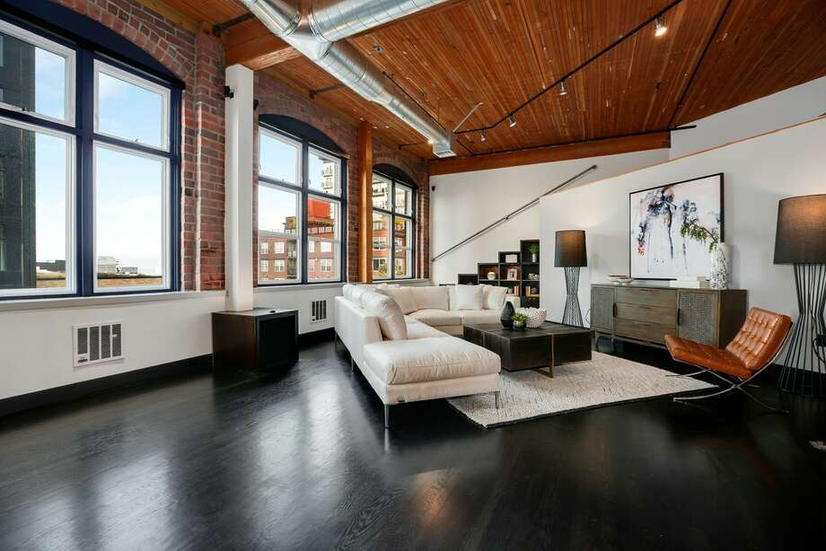 Converted from a historic printing press, this Belltown loft has dropped its asking price to $1.015 million. Photo: Redfin Corp