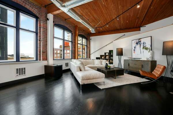 Converted from a historic printing press, this Belltown loft has dropped its asking price to $1.015 million.