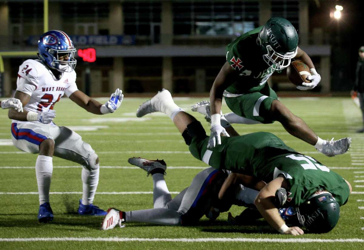 Strake Jesuit Crusaders running back Dylan Campbell (9) hurdles his own teammate for a touchdown against the West Brook Bruins in the second quarter of high school playoff football game on November 22, 2019 at Challenger Stadium in Waller, TX.