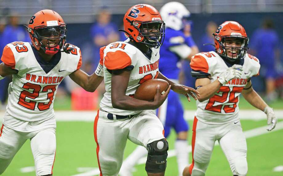 Linebacker Jordan Flowers runs off the field with the ball after his final interception for the Broncos seals the victory 35-21 as Brandeis plays Clemens in the second round of high school football playoffs at the Alamodome on Nov. 22, 2019. Photo: Tom Reel, San Antonio Express-News / Staff Photographer / **MANDATORY CREDIT FOR PHOTOG AND  SAN ANTONIO EXPRESS-NEWS/NO SALES/MAGS OUT/TV