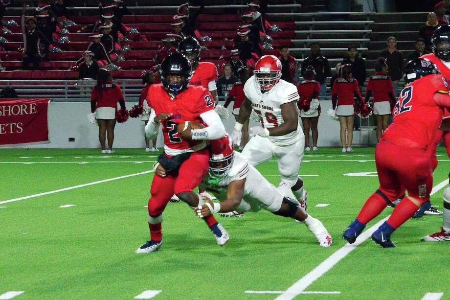 Dawson quarterback Myles Kitt-Denton (2) tries to elude Galena Park North Shore's Corey Flagg Jr. (2) Friday night in Pasadena. Photo: Kirk Sides / Staff Photographer / © 2019 Kirk Sides / Houston Chronicle