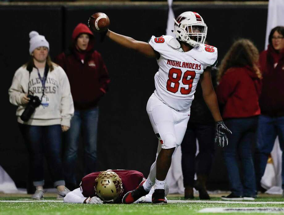 The Woodlands wide receiver Brenden Langford-Johnson (89) reacts after hauling in a 12-yard touchdown pass over Cypress Woods defensive back Trajan Armstrong (12) during the third overtime period of a Region II-6A area high school football playoff game at Cy-Fair FCU Stadium, Friday, Nov. 22, 2019, in Cypress. The Woodlands defeated Cypress Woods 34-28 in triple overtime. Photo: Jason Fochtman, Houston Chronicle / Staff Photographer / Houston Chronicle