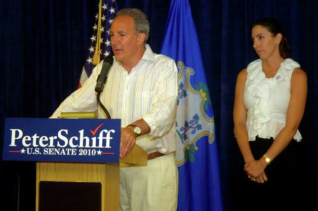 Peter Schiff, withs fiancee Martha O'Brien concedes the Republican primary on Tuesday, August 10, 2010 and the Hilton Garden Inn in Milford. Photo: Lindsay Niegelberg / Connecticut Post