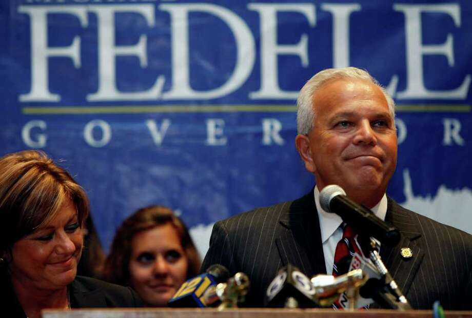 Republican candidate for governor, Connecticut Lt. Gov. Michael Fedele, concedes the race to Republican Tom Foley after the results of the Connecticut primary election Tuesday, Aug. 10, 2010 in Stamford, Conn. Left is Fedele's wife, Carol Fedele. (AP Photo/Craig Ruttle) Photo: AP