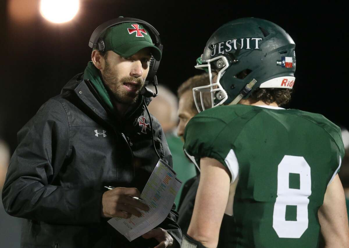 Strake Jesuit Crusaders quarterback William Dickason (8) talks with head coach Klay Kubiak on the sidelines while the Crusaders play against the West Brook Bruins in the first quarter of high school playoff football game on November 22, 2019 at Challenger Stadium in Waller, TX.