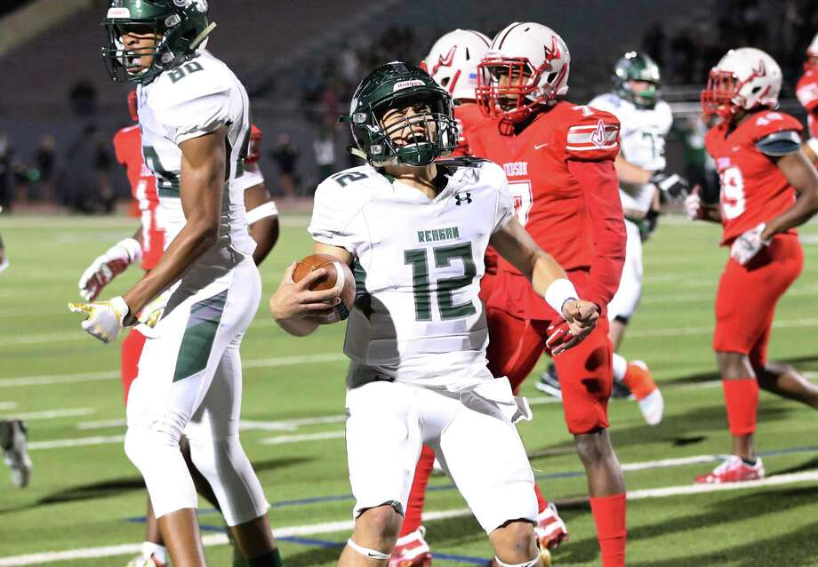 Reagan quarterback Lance Lorenz (12) reacts after the Rattlers strike first with a touchdown score against Judson during their football game in the second round of Class 6A Div. I playoffs at Alamo Stadium on Friday, Nov. 22, 2019. Photo: Kin Man Hui, San Antonio Express-News / Staff Photographer / **MANDATORY CREDIT FOR PHOTOGRAPHER AND SAN ANTONIO EXPRESS-NEWS/NO SALES/MAGS OUT/ TV OUT