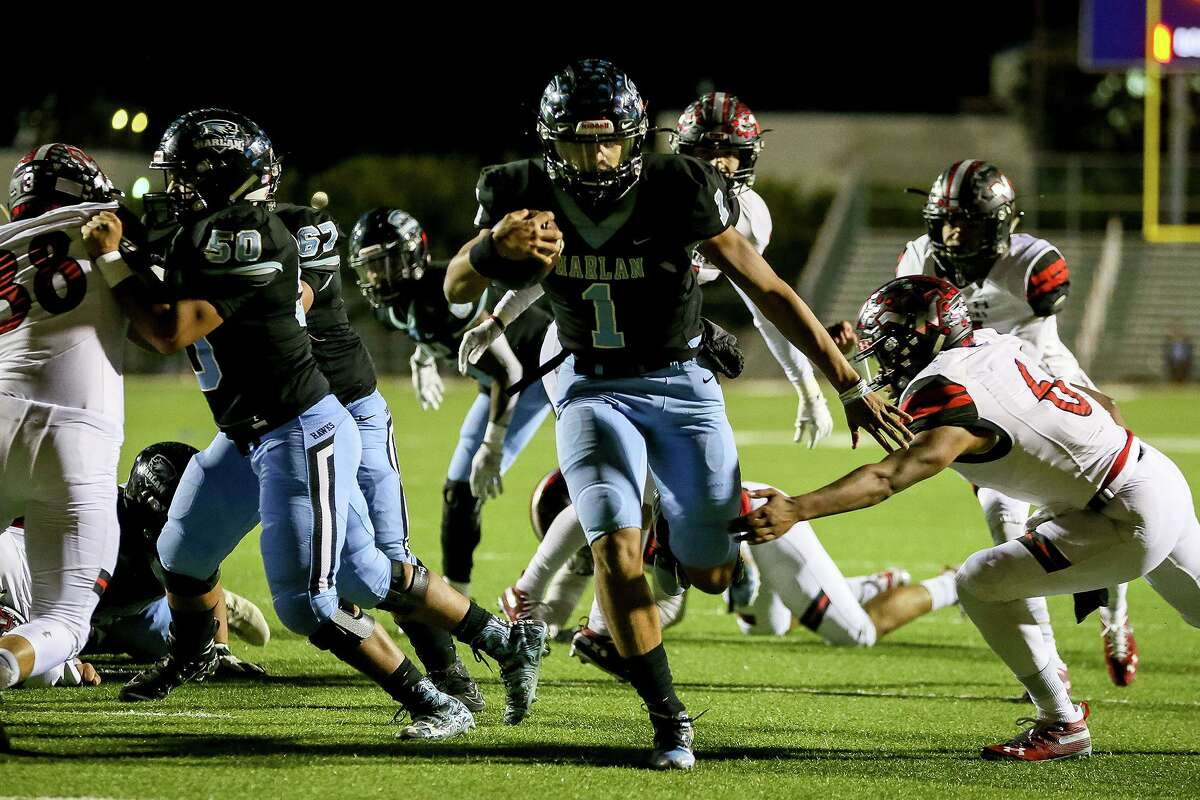Harlan quarterback Kannon Williams scores on a 5-yard run during the first half of their second round Class 5A Division I high school football playoff game with Victoria West at Farris Stadium on Friday, Nov. 22, 2019.