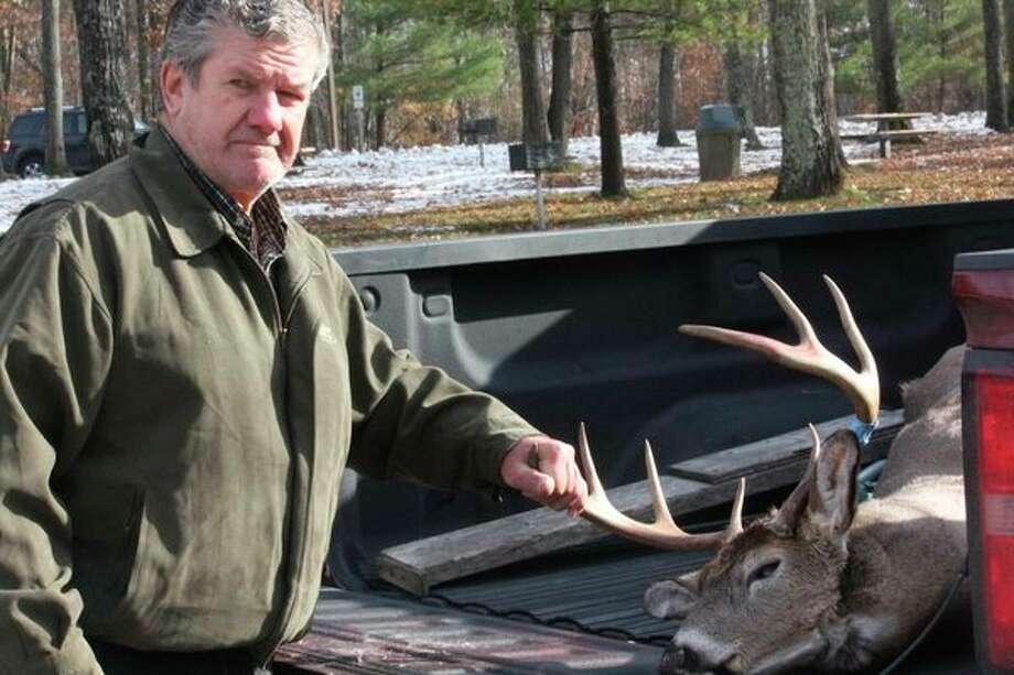 Jerry Schrauben shows the 8-point buck he shot opening morning in Lake County. (Pioneer photo/John Raffel)