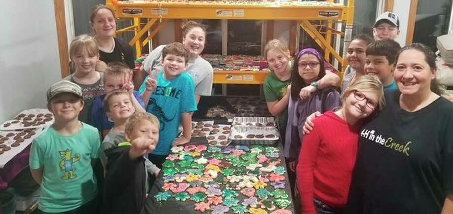 The 4-H in the Creek, a 4-H club comprised of Bullock Creek students, recently baked over 80 dozen holiday cookies to be distributed at the Santa House lighting on Dec. 3. The club topped last year's club record of 77 dozen treats. This activity is one of the club's favorite community service projects. Club members pictured include Grayson Wells, Oliver Wells, Will Reinke, Grant Reinke, Brooke Reinke, Levi Czolgosz, Graci Whyte, Madison Crawford, Lilli Whyte, Shea Arnold, Ariana Swantek, Carter Wells, Connor Czolgosz, Maci Reinke and Club Leader Traci Wells. (Photo provided)