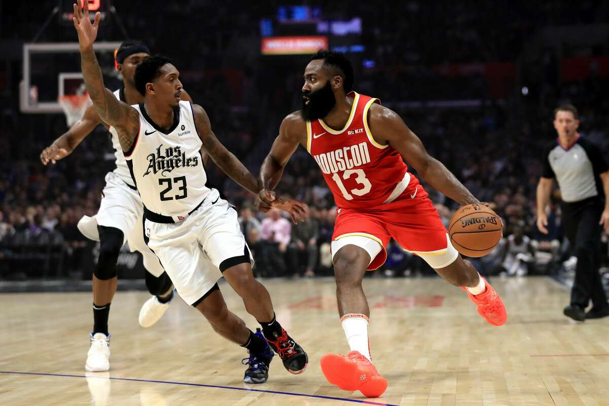 LOS ANGELES, CALIFORNIA - NOVEMBER 22: James Harden #13 of the Houston Rockets dribbles into the defense of Lou Williams #23 of the Los Angeles Clippers during the first half of a game at Staples Center on November 22, 2019 in Los Angeles, California. (Photo by Sean M. Haffey/Getty Images)