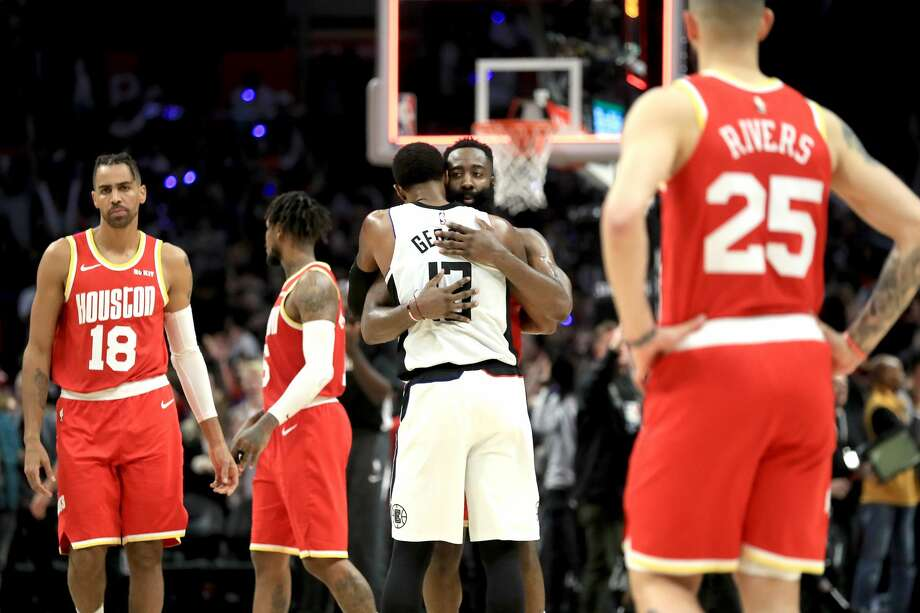 LOS ANGELES, CALIFORNIA - NOVEMBER 22: Paul George #13 of the Los Angeles Clippers is congratulated by James Harden #13 as Austin Rivers #25 and Thabo Sefolosha #18 of the Houston Rockets look on after a game at Staples Center on November 22, 2019 in Los Angeles, California. The Los Angeles Clippers defeated the Houston Rockets 122-119. NOTE TO USER: User expressly acknowledges and agrees that, by downloading and/or using this photograph, user is consenting to the terms and conditions of the Getty Images License Agreement (Photo by Sean M. Haffey/Getty Images) Photo: Sean M. Haffey/Getty Images