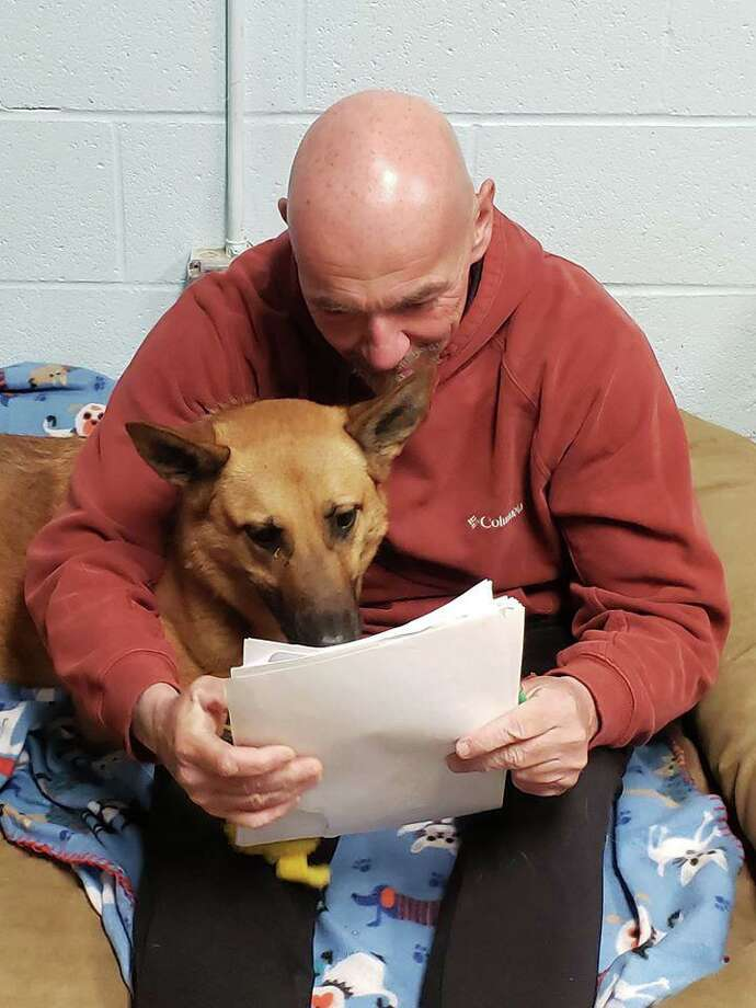 Harwinton Animal Control Officer Tom Mitchell and Flash read the flood of inquiries about adopting Flash after a Hearst Connecticut Media report about the dog, who was trained to be a police dog bit has remained in the pound for two years. Photo: Submitted / Harwinton Animal Control, Tom Mitchell