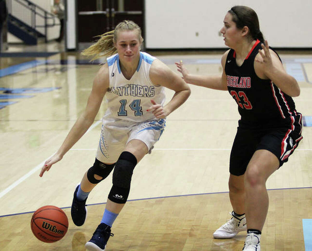 Jersey's Lauren Brown (left) drives on Highland's Taylor Kesner during a game last season in Jerseyville. On Friday night at the Alton Tournament, Brown scored a career-high 16 points to help the Panthers beat Breese Mater Dei.