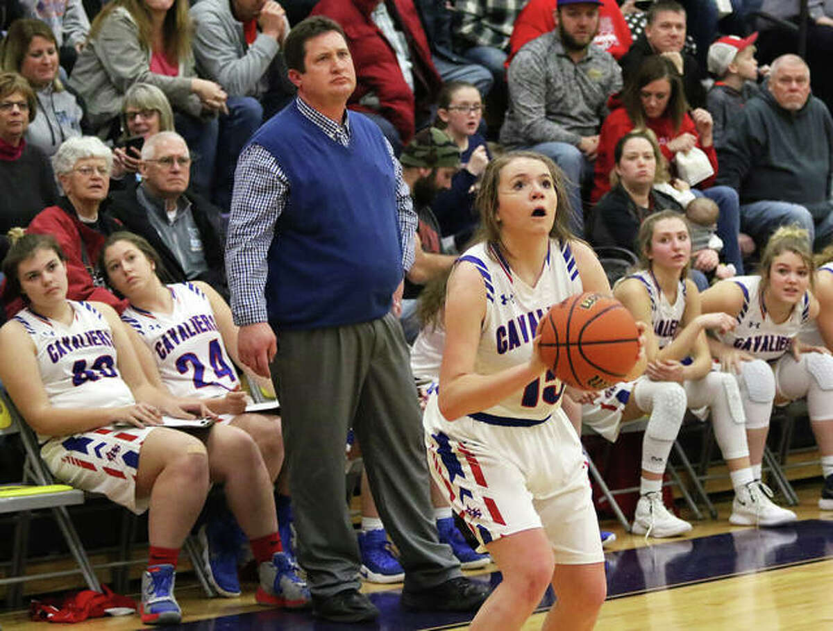 Carlinville's Gracie Reels sets to launch a 3-pointer in front of coach Darrin DeNeve and the Cavaliers bench during a game last season. Reels scored a career-high 14 points in the Cavs win over Brussels on Friday night at the Carlinville Tip-Off Classic.