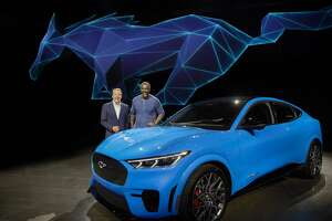 Ford Motor Co. Executive Chairman Bill Ford, left, and actor Idris Elba with the upcoming all-electric Mustang Mach-E GT SUV in Hawthorne, Calif. where Elba, who worked at Ford Motor Co. in the 1980s, helped introduce the Mach-E.