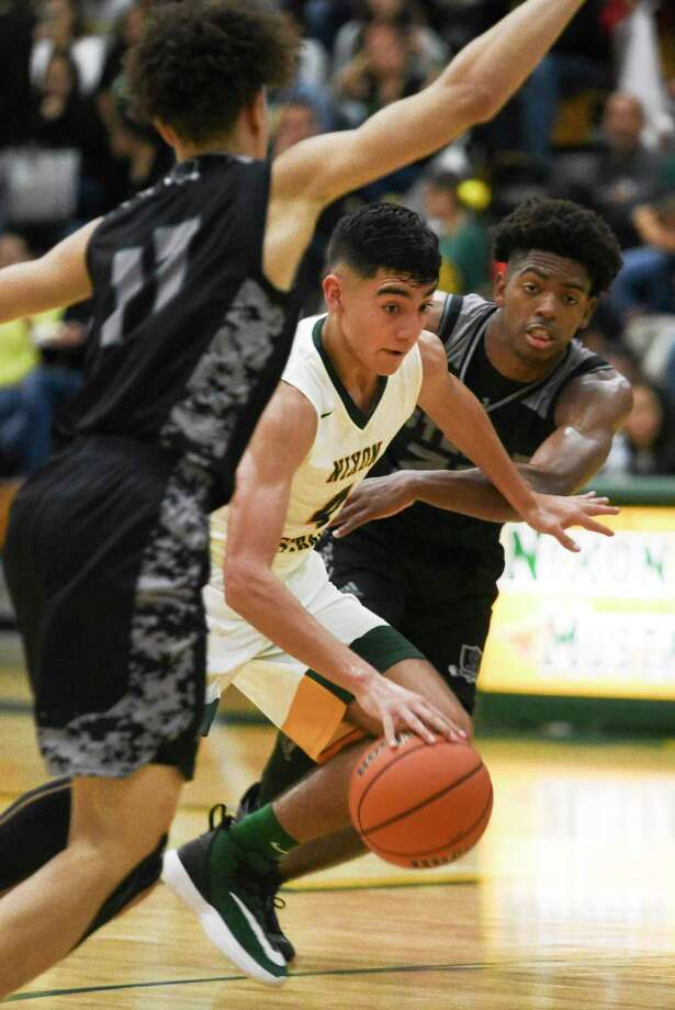 Nixon High School Juan Marines drives the ball down the court during a game against Cibolo Steele High School, Friday, Nov. 22, 2019, at Nixon High School. Photo: Danny Zaragoza, Staff Photographer / Laredo Morning Times