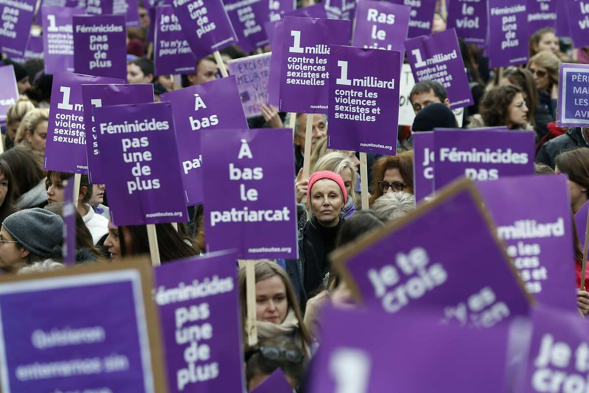"""Women hold placards as they march against domestic violence, in Paris, Saturday, Nov, 23, 2019. Activists hold a march through Paris to pressure the French government to take bold steps to prevent deadly domestic violence, a problem President Emmanuel Macron calls """"France's shame."""" France has among the highest rates in Europe of domestic violence, in part because of poor police response to reports of abuse. (AP Photo/Thibault Camus)"""