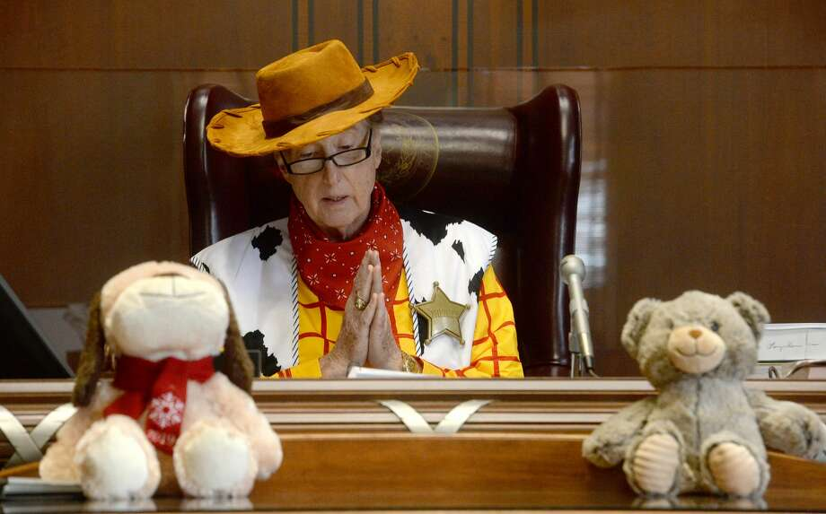 Judge Larry Thorne, aka Sheriff Woody, addresses the gathering from the bench in the 317th District courtroom as he presides over multiple adoption proceedings on National Adoption Day at the Jefferson County Courthouse Friday. Photo taken Friday, November 22, 2019 Kim Brent/The Enterprise Photo: Kim Brent/The Enterprise