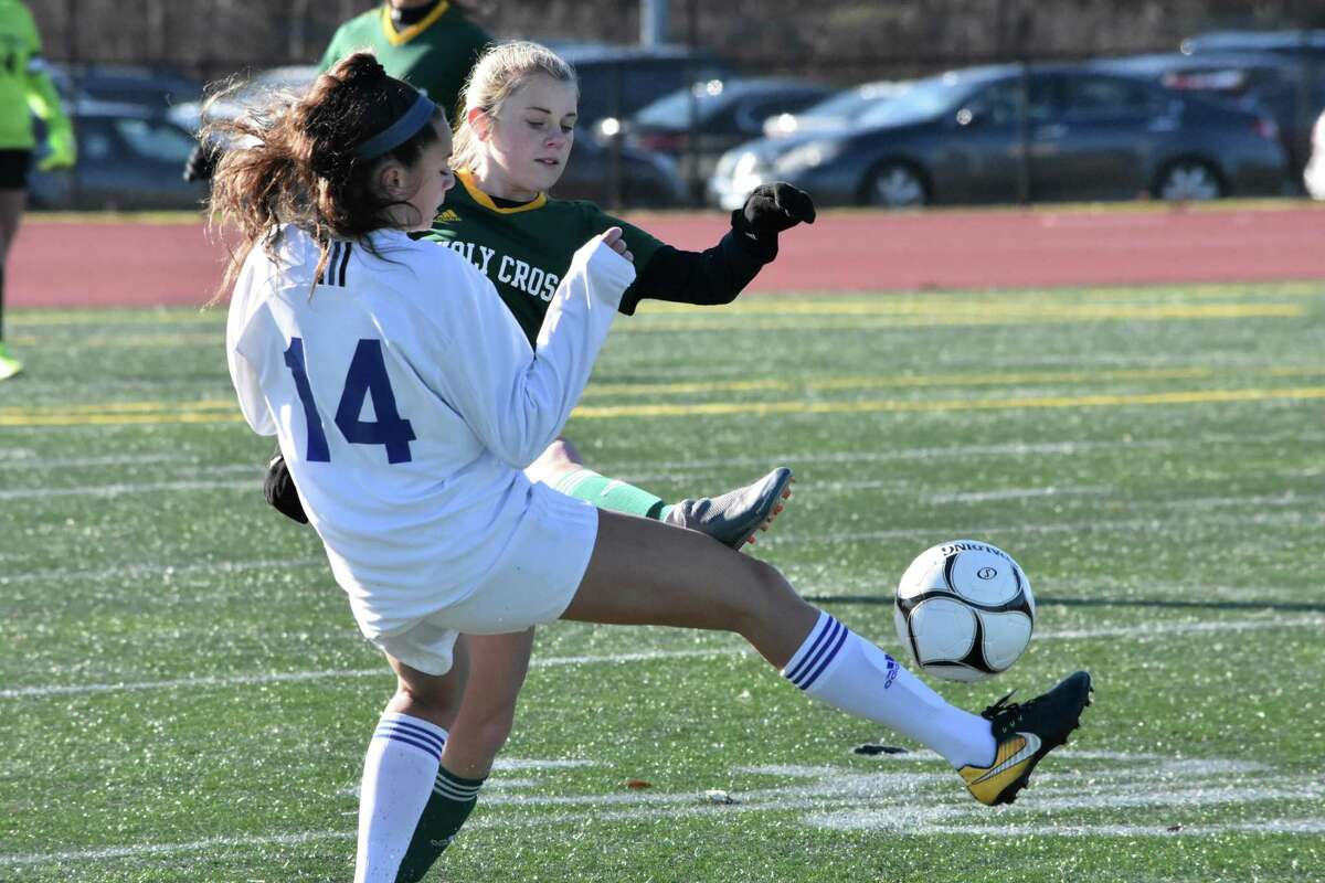 Holy Cross' Alexa Diorio and Old Lyme's Abigail Manthous battle for the ball during the Class S girls soccer State Championship at Veterans Stadium, New Britain on Saturday, Nov. 23, 2019. (Pete Paguaga, Hearst Connecticut Media)