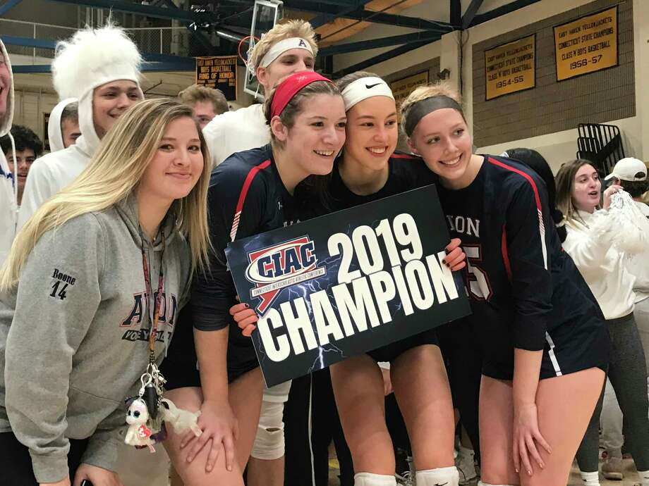 Members of the Avon volleyball team celebrate the program's first state title, a 3-0 win over Guilford in the CIAC Class L championship match at East Haven High School on Saturday, Nov. 23, 2019. Photo: Michael Suppe / For Hearst Connecticut Media