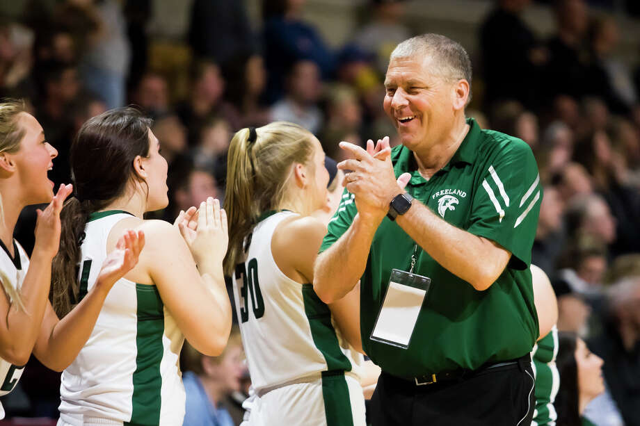 Freeland girls' basketball coach Tom Zolinski celebrates his team's state semifinal victory over Hamilton at Calvin College last March. Photo: Daily News File Photo