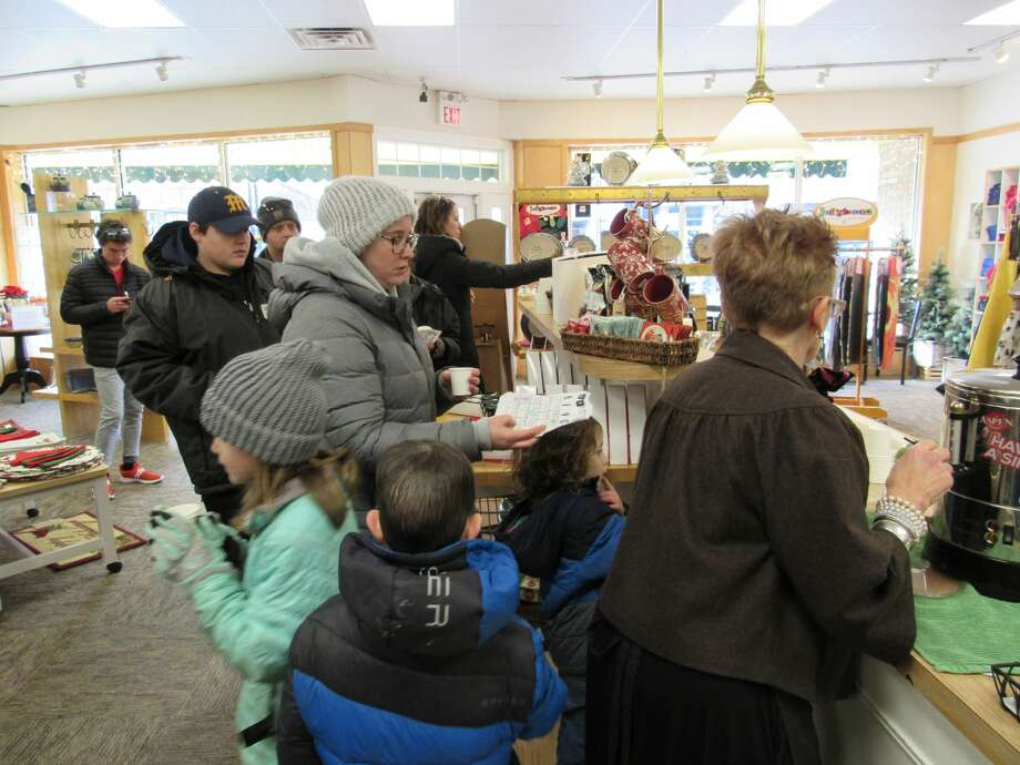 People visit downtown businesses and organizations during the Midland Downtown Business Association's Hot Cocoa Crawl on Saturday, Nov. 23. Photo: Victoria Ritter/vritter@mdn.net