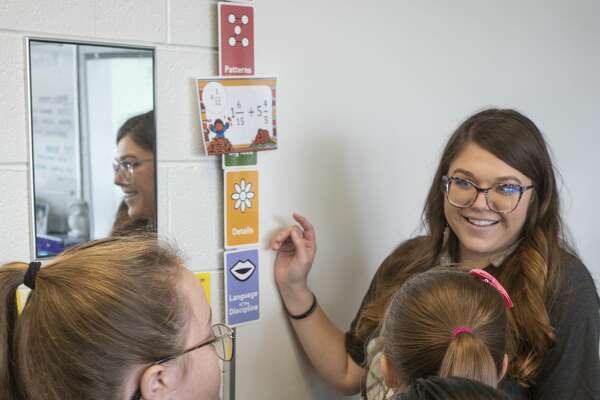 Trazi Wihebrink works with her fifth graders 11/22/19 at Carver Center. Tim Fischer/Reporter-Telegram
