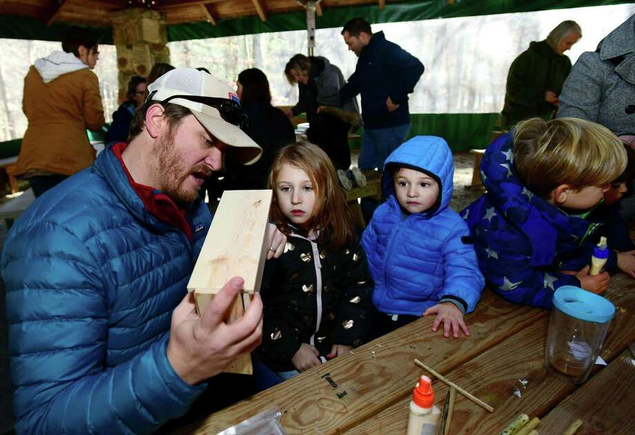Wilton residents Brice Chaney and his kids, Piper, 5, and Declan, 2, build bee houses during the Woodcock Nature Center Mason Bee Workshop. Photo: Erik Trautmann / Hearst Connecticut Media / Norwalk Hour