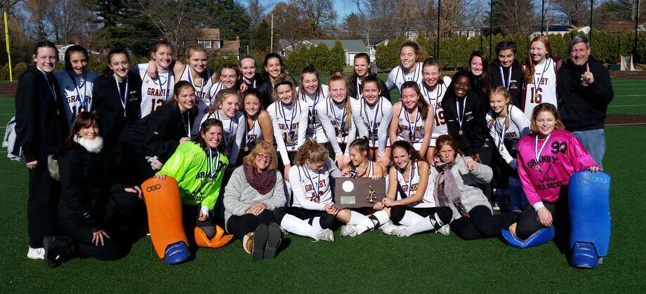 Members of the Granby field hockey team celebrate after their 1-0 win over North Branford Saturday in the Class S championship game. It is the Bears 14th state title. Photo: Dan Nowak / Hearst Connecticut Media