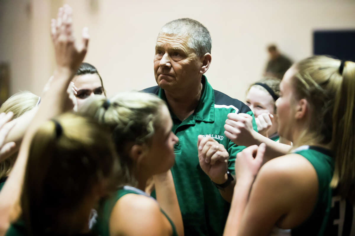 Freeland coach Tom Zolinski meets with his players during a timeout in a Division 2 quarterfinal game vs. Cadillac last March.