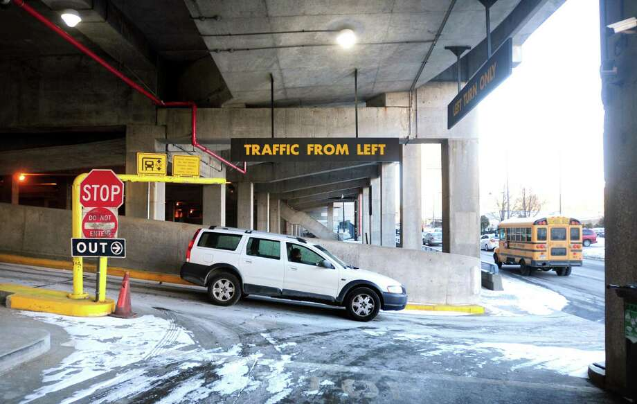 FILE PHOTO: A car exits from the Air Rights Garage onto North Frontage Road in New Haven, Conn. Photo: Hearst Connecticut Media / Arnold Gold