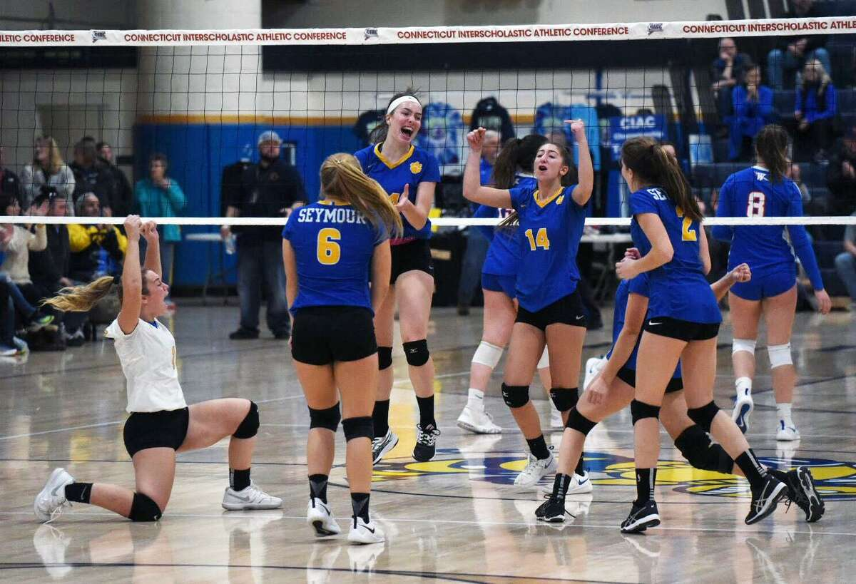 The Seymour volleyball team celebrates after winning a point during the fourth set in the CIAC Class M championship at East Haven High in 2019. Seymour defeated Watertown,3-1, and repeated as state champs.