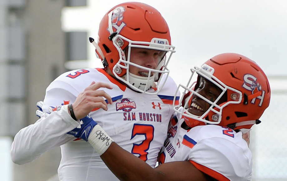 Sam Houston State quarterback Eric Schmid (3) celebrates his touchdown run with Tyler Scott during the first half of an NCAA college football game against Houston Baptist, Saturday, Nov. 17, 2018, in Houston. Schmid completed eight of his first nine pass attempts for 117 yards and a touchdown in Saturday's win over Houston Baptist. (Eric Christian Smith/Contributor) Photo: Eric Christian Smith/Contributor