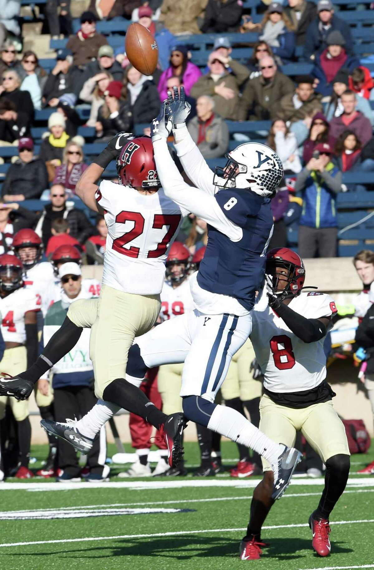Harvard's Cody Thompson breaks up a pass play to Yale's Patrick Conte in the first half Saturday in New Haven.