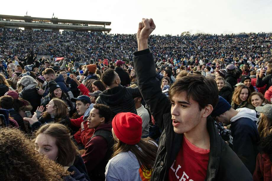 Climate change activists storm the field during halftime of the Yale-Harvard football game in New Haven, a protest that delayed the 144th edition of The Game for more than an hour. Photo: Monica Jorge / New York Times