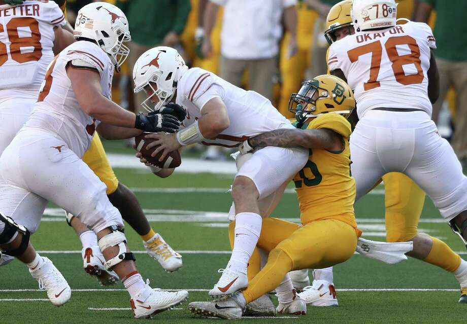 WACO, TEXAS - NOVEMBER 23:  Sam Ehlinger #11 of the Texas Longhorns is sacked by Terrel Bernard #26 of the Baylor Bears in the first half at McLane Stadium on November 23, 2019 in Waco, Texas. Photo: Ronald Martinez, Getty Images / 2019 Getty Images