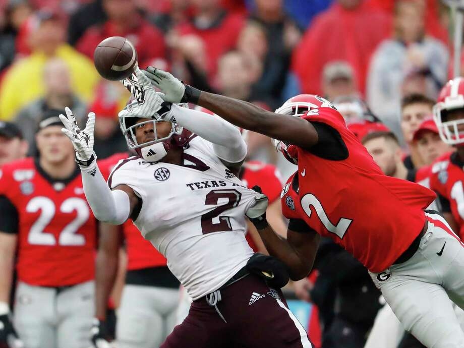 Texas A&M wide receiver Jhamon Ausbon (2) makes a catch as Georgia defensive back Richard LeCounte (2) defends in the first half of an NCAA college football game Saturday, Nov. 23, 2019, in Athens, Ga. (AP Photo/John Bazemore) Photo: John Bazemore, Associated Press / Copyright 2019 The Associated Press. All rights reserved