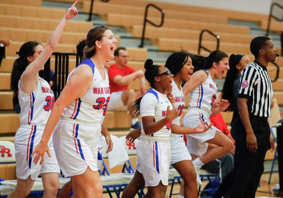 Oak Ridge players celebrate after defeating Cypress Springs 59-55 in overtime to win the Lady War Eagle Varsity Shootout, Saturday, Nov. 23, 2019, in Oak Ridge. Photo: Jason Fochtman, Houston Chronicle / Staff Photographer / Houston Chronicle