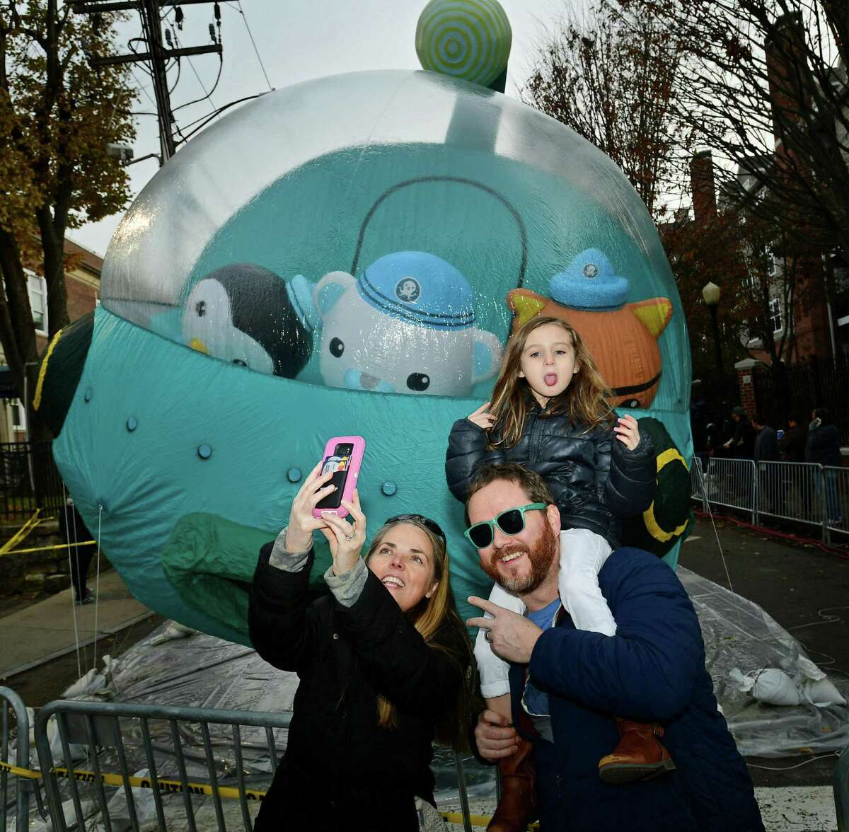 Fairfield residents Bridget Grabell, Brian Grabell and their daughter, Sadie Grabell, 7, watch as Big Event Inc employees inflate parade balloons. Below, Big Event Inc employees Marilyn Cruz inflates a parade balloon during the event.