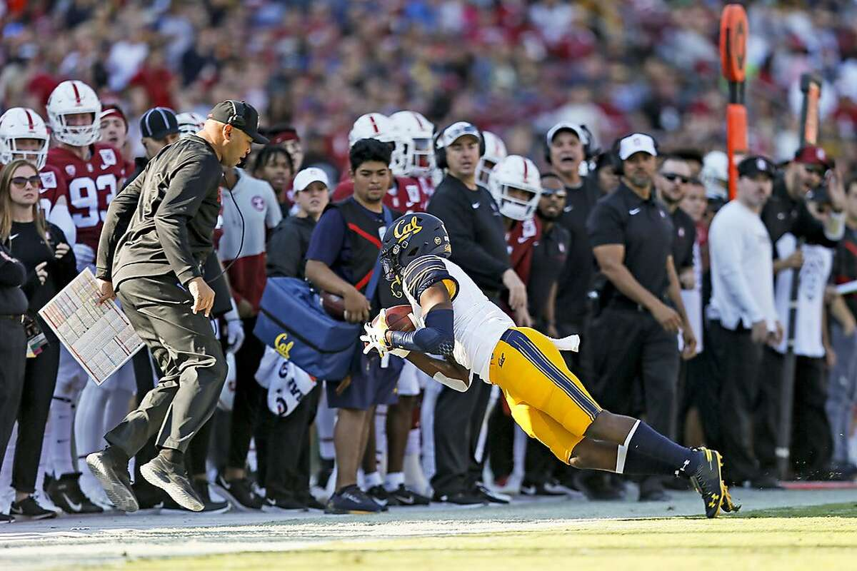 California Golden Bears wide receiver Jordan Duncan (2) completes the sideline reception near Stanford Cardinal head coach David Shaw in the first half of the 122nd Big Game at Stanford Stadium on Saturday, Nov. 23, 2019, in Stanford, Calif.