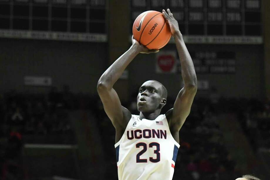 Connecticut's Akok Akok (23) shoots in the first half of an NCAA college basketball game against Sacred Heart Friday, Nov. 8, 2019, in Storrs, Conn. (AP Photo/Stephen Dunn) Photo: Stephen Dunn / Associated Press / Copyright 2019 The Associated Press. All rights reserved