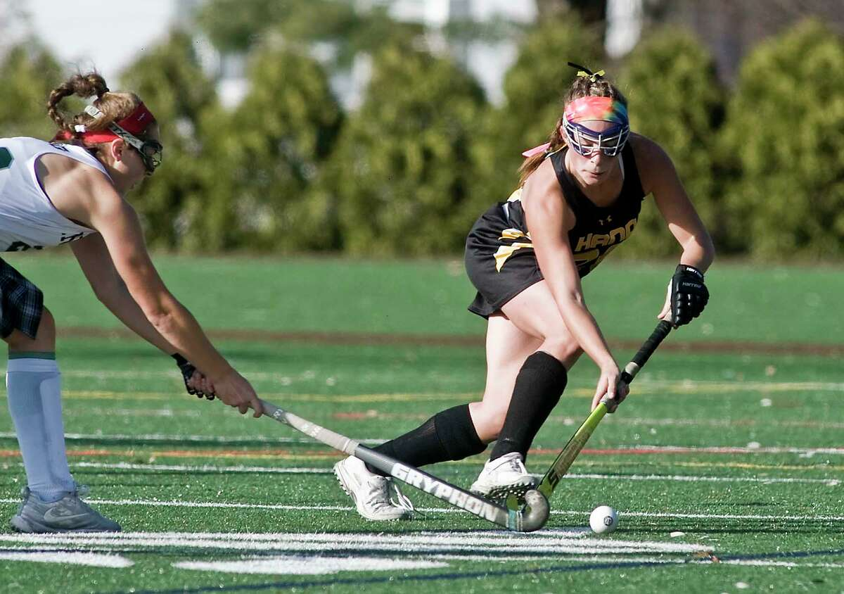 Daniel Hand High School's Carly-Anna Barba picks up the ball in the Class M state field hockey championship game against Guilford High School, played at Wethersfield High School. Saturday, Nov. 23, 2019