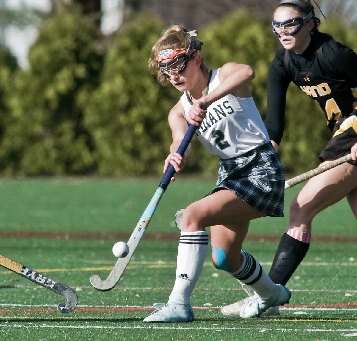 Guilford's Ella Stanley tries to control the ball in the Class M state field hockey championship game against Hand in November.