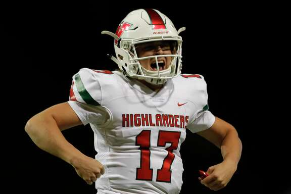 The Woodlands quarterback Cody Howard (17) threw two touchdown passes in overtime to help his team beat Cypress Woods 34-28 on Friday night.