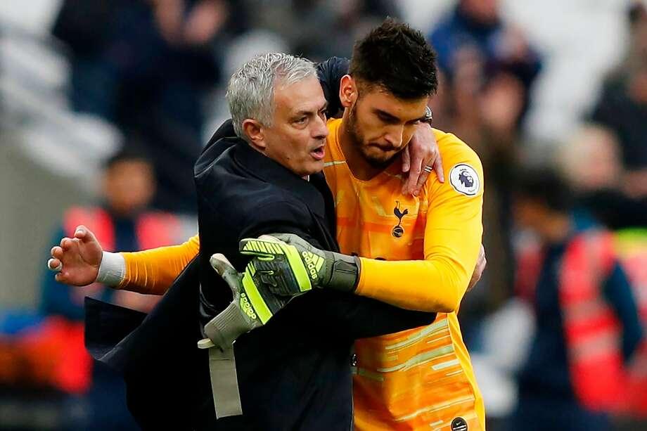 Tottenham manager Jose Mourinho hugs goalkeeper Paulo Gazzaniga after win No. 1. Photo: Adrian Dennis / AFP Via Getty Images