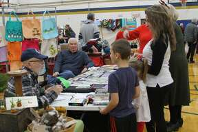 The Christmas in Onekama craft show on Saturday at Onekama High School saw more than 40 vendors and hundreds of patrons. The annual event, which is a fundraiser of the Portage Lake Association, also included a chili cook-off.