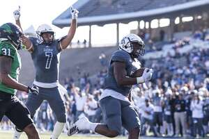 Rice running back Charlie Booker (23) runs for a touchdown during the first half of college football game Saturday, Nov 23, 2019, in Houston.